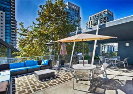 Atria Condos San Diego - roof top deck with BBQ & fireplace areas